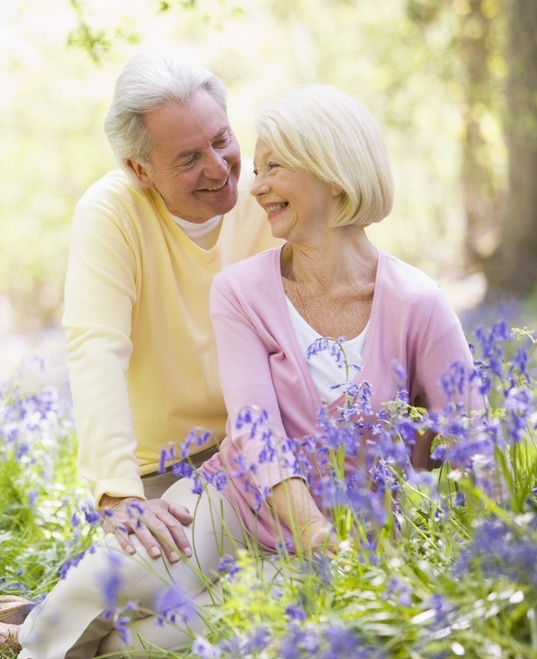 Two pensioners in a flowered field