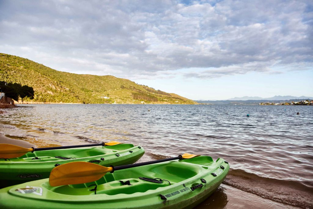 Kayaks at the lagoon at Under Milkwood Chalets