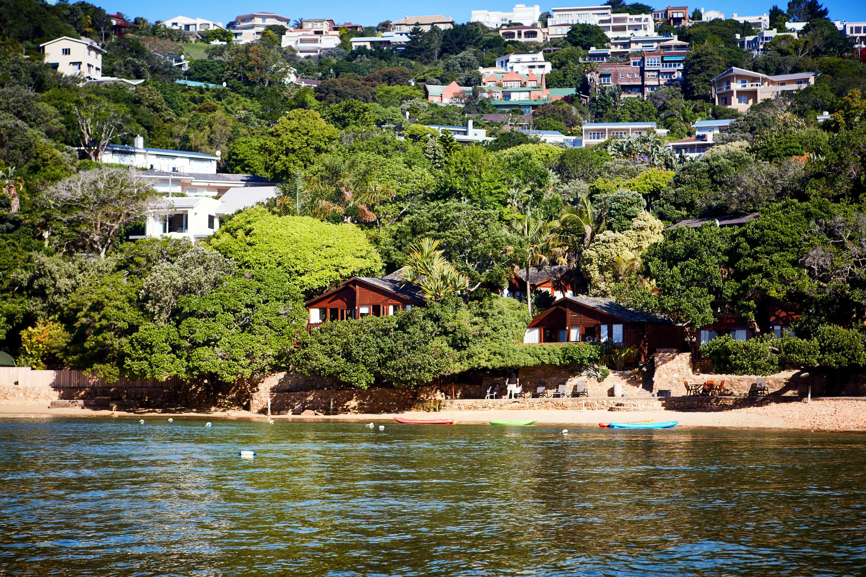 A view of Under Milkwood Chalets from the lagoon
