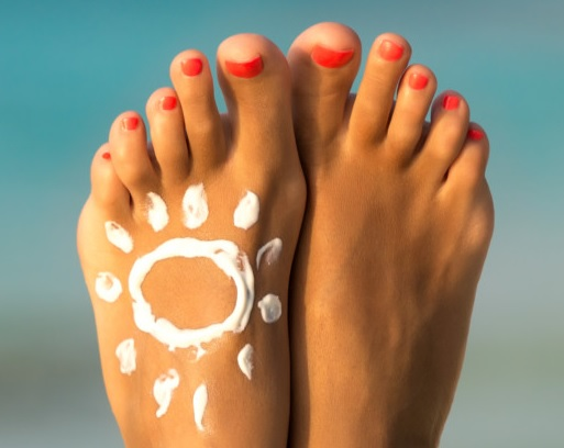 Feet in the sun with the UVF sun picture on