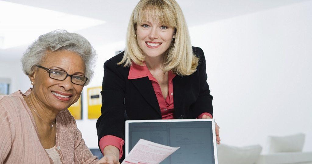 senior woman with financial advisor