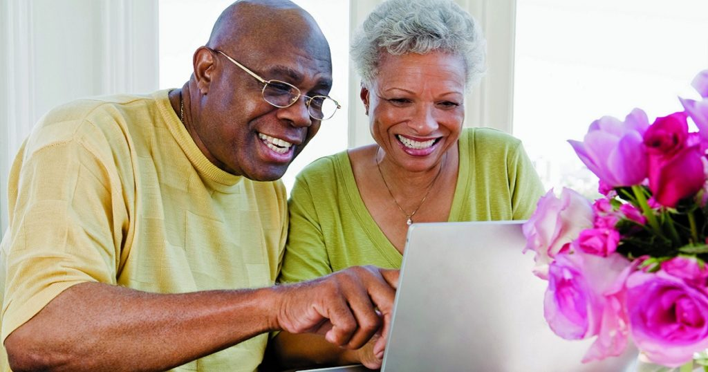 senior couple using laptop