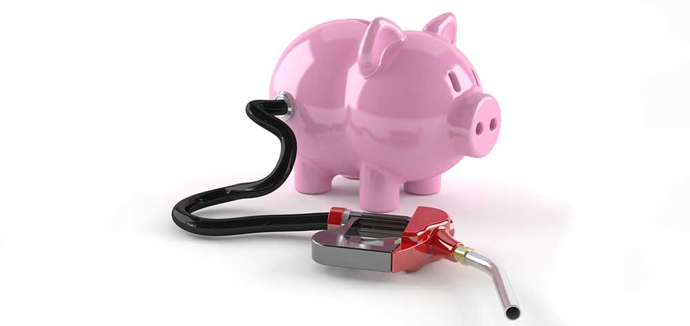 savings pig and petrol pump