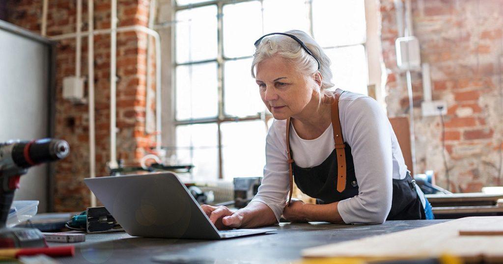 senior woman working on laptop
