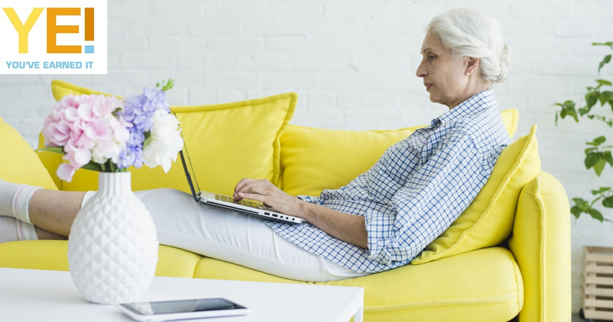 Lady on couch with laptop 1200