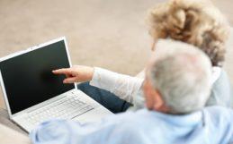senior couple and laptop