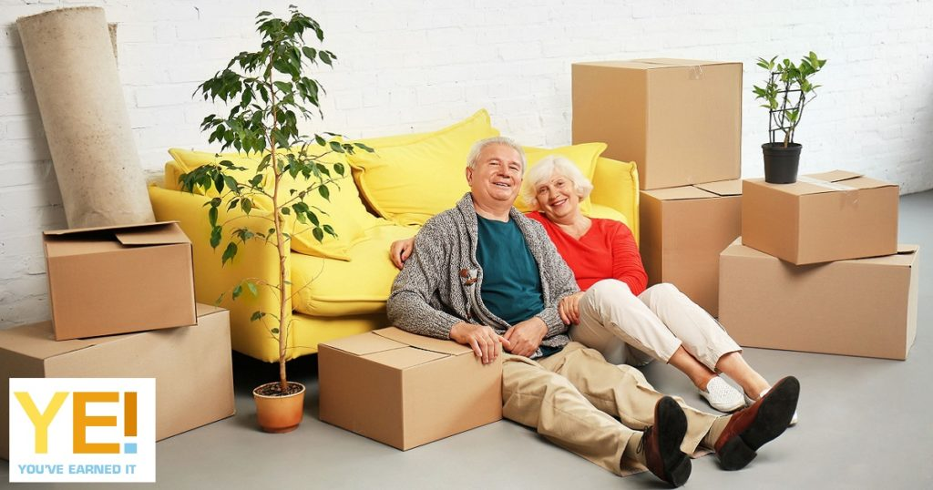 couple and packed boxes